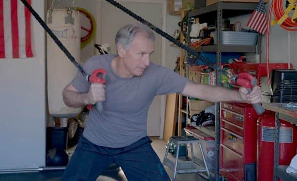 Fit guy Dan Young boxing in his garage with the CATALYZER™