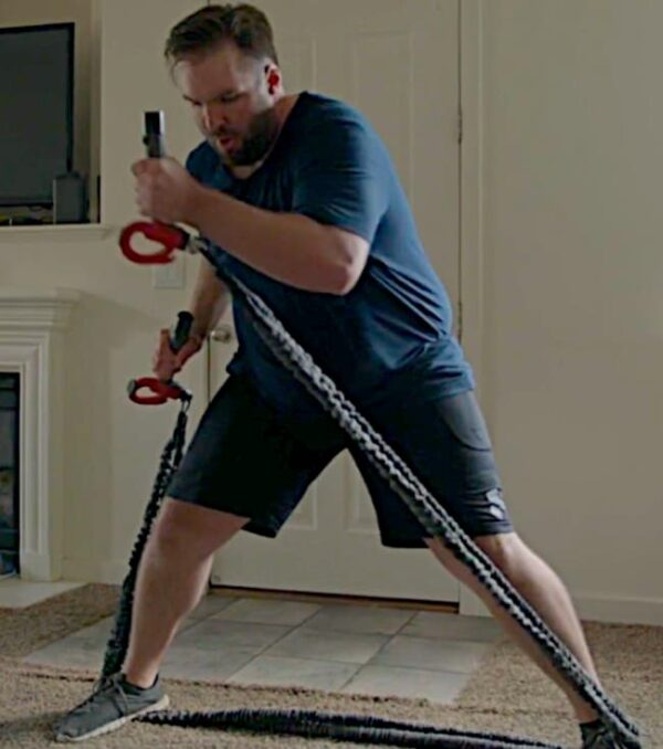 Tyler using his CATALYZER at home, working full body workout with handles, weights and 2 PowerCords